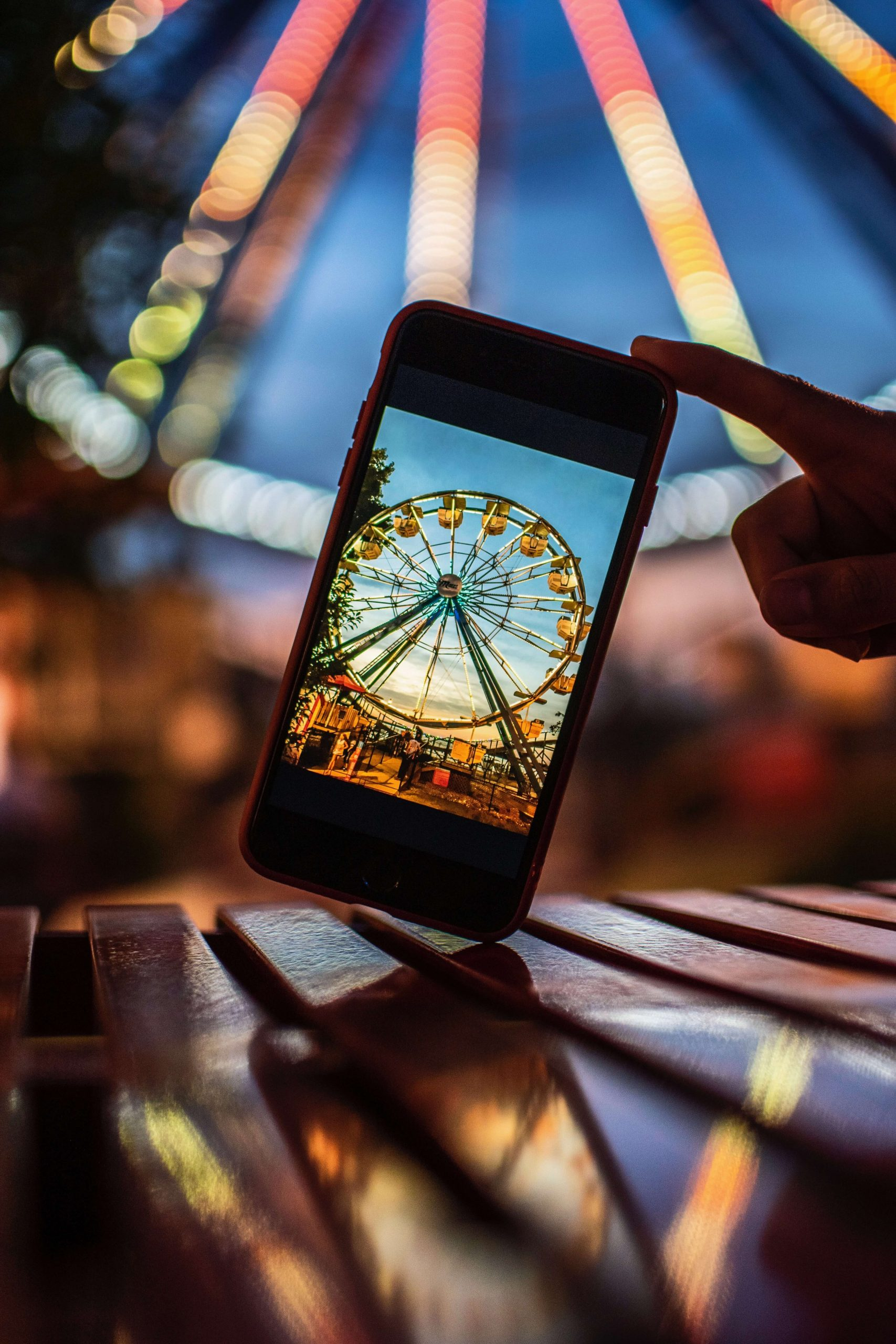 An artist takes a picture of a Ferris wheel