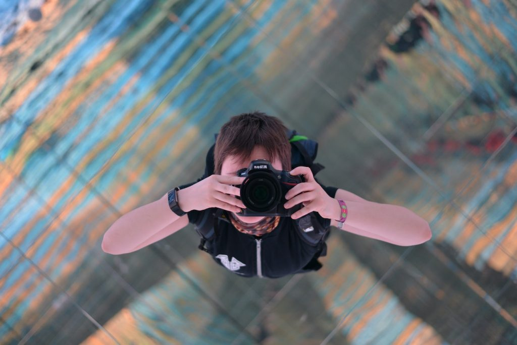 A photographer taking a picture to the sky